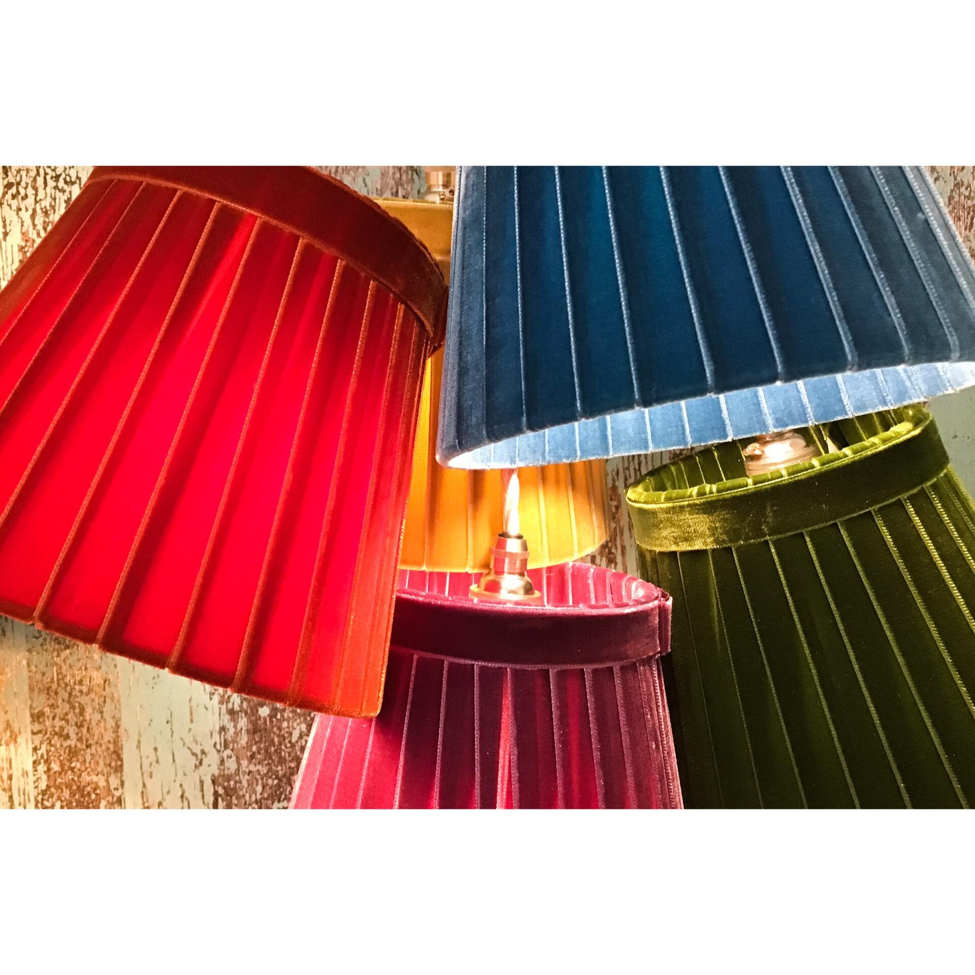 Cluster of velvet pendent lampshades