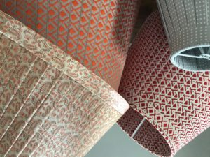 Close up of orange and red ribbon lampshades
