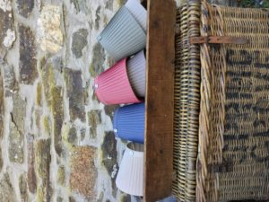 Barrington Ribbon Lampshades in wooden trough on basket